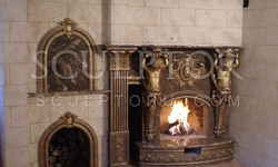 Fireplace with sculpture and decorative plaster